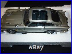 A Danbury mint scale model car of a James Bond's Aston Martin DB5, Goldfinger