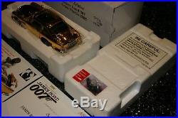 DANBURY MINT ASTON MARTIN JAMES BOND GOLD DB5 1st EDITION WITH BOX CERTIFICATE