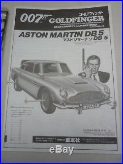 Doyusha Un-made plastic kit of a James Bond's Aston Martin DB5, with figures