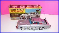 Gilbert James Bond Aston Martin 1965 Tin Toy Battery Operated with Original Box
